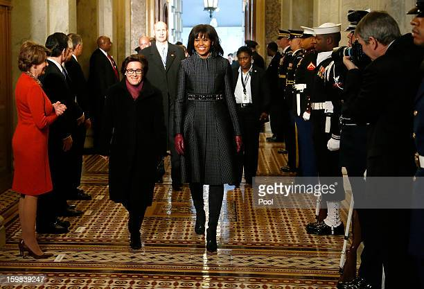 S first lady Michelle Obama arrives at the carrieage entrance of the US Capitol to begin swearingin ceremonies on January 21 2013 in Washington DC US...