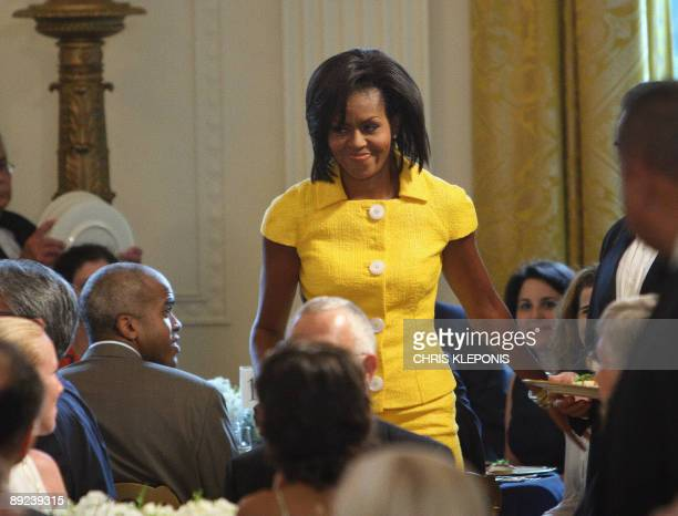 US First Lady Michelle Obama arrives to addresses the 10th annual Design Awards luncheon in the East Room of The White House in Washington DC on July...