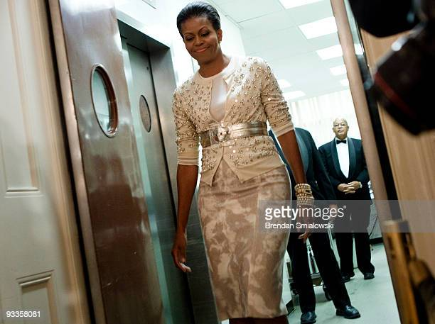 First Lady Michelle Obama arrives to speak at a preview for tonight's State Dinner in the State Dining Room of the White House November 24 2009 in...