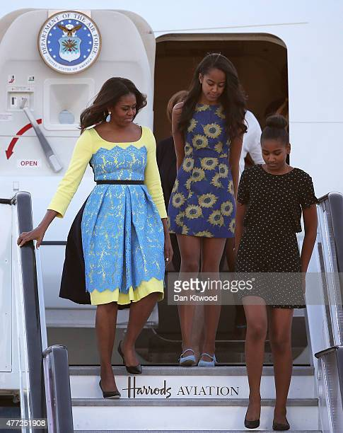 First Lady Michelle Obama arrives with daughters Malia Obama and Sasha Obama at Stanstead airport on June 15 2015 in London England The First Lady is...