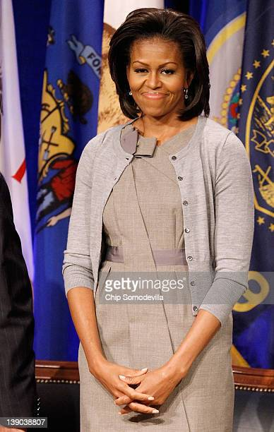S first lady Michelle Obama attends an event to announce a new report regarding military spouse employment at the Pentagon February 15 2012 in...
