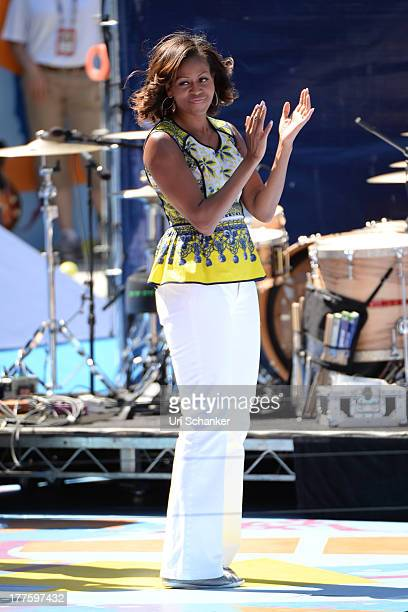 First Lady Michelle Obama attends the 2013 Arthur Ashe Kids Day at USTA Billie Jean King National Tennis Center on August 24, 2013 in the Queens...
