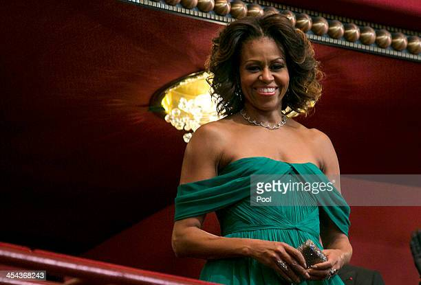 First Lady Michelle Obama attends the 2013 Kennedy Center Honors on December 8 2013 in Washington DC The honorees this year include opera singer...