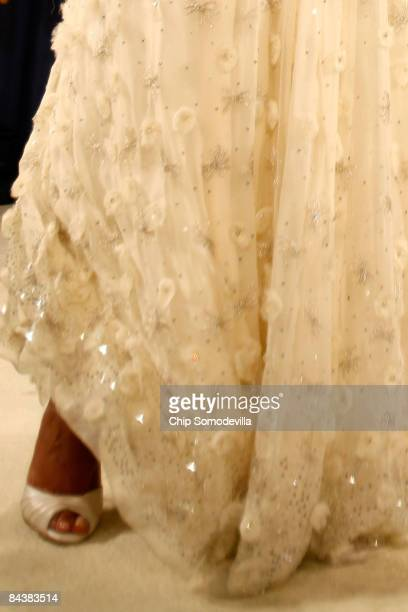 First Lady Michelle Obama attends the Biden Home States Ball at the Washington Convention Center on January 20 2009 in Washington DC Obama became the...
