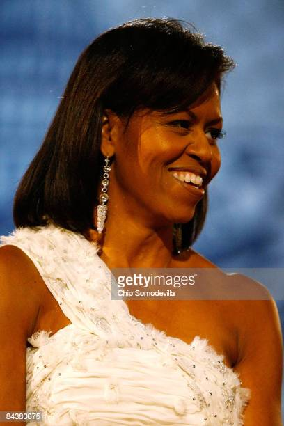 First Lady Michelle Obama attends the Neighborhood Inaugural Ball at the Washington Convention Center on January 20, 2009 in Washington, DC. Obama...