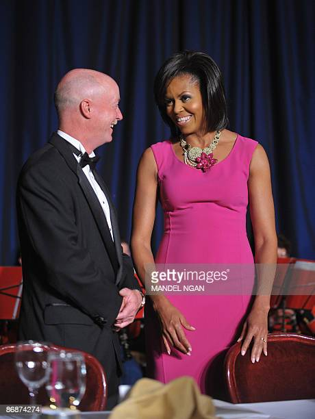 First Lady Michelle Obama chats with photographer Dough Mills of the New York Times during the White House Correspondents� Association annual dinner...