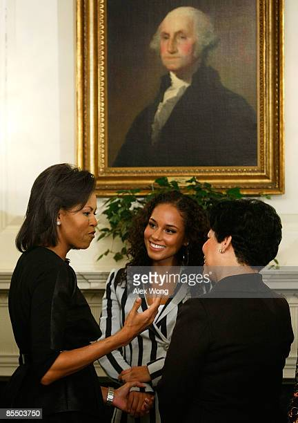 S first lady Michelle Obama chats with RB singersongwriter Alicia Keys and BET Holdings Inc CEO Debra Lee as she greets with women leaders in the...