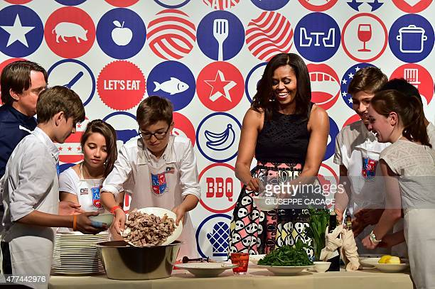 First Lady Michelle Obama cooks with young from the American School of Milan at the James Beard American Restaurant during a visit in Milan on June...