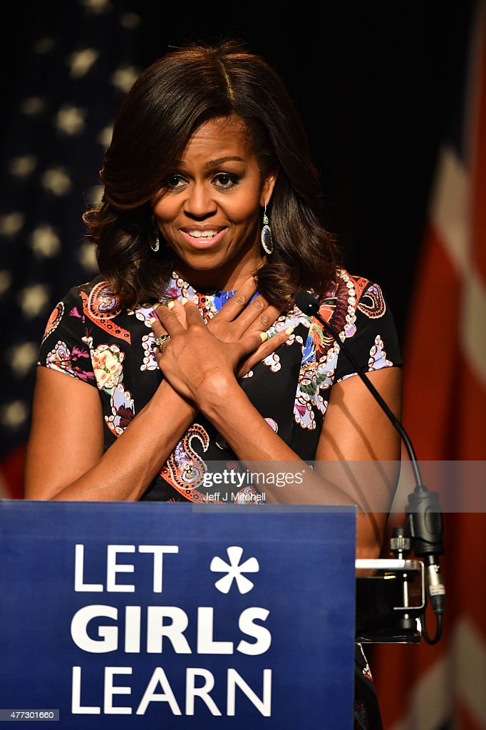 US First Lady Michelle Obama crosses her hands on her chest as she speaks to students as part of the 'Let Girls Learn Initiative' at the Mulberry School for Girls on June 16, 2015 in London, England. The US First Lady is travelling with her daughters, Malia and Sasha and her mother, Mrs. Marian Robinson, to continue a global tour promoting her 'Let Girls Learn Initiative'. The event at the school was to discuss how the UK and USA are working together to expand girl's education around the world.