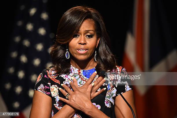 First Lady Michelle Obama crosses her hands on her chest as she speaks to students as part of the 'Let Girls Learn Initiative' at the Mulberry School...