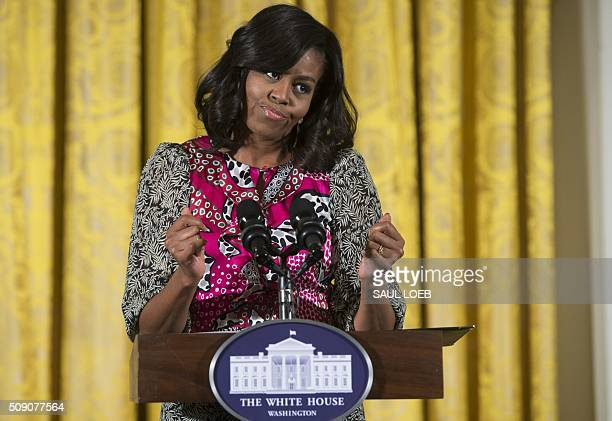 US First Lady Michelle Obama dances as she speaks during a daylong dance workshop to highlight contributions African American women have made to...