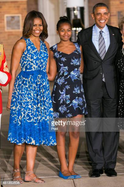 First lady Michelle Obama daughter Sasha Obama and US President Barack Obama attend the Marine Barracks Evening Parade on June 27 2014 in Washington...