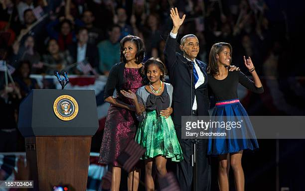 First lady Michelle Obama daughter Sasha Obama President Barack Obama and daughter Malia Obama appear after Obama's victory speech on election night...