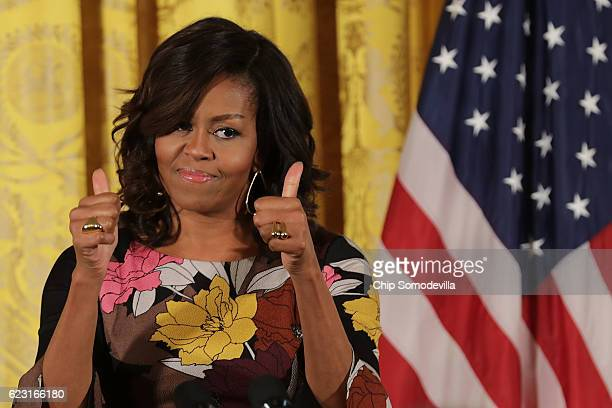 S first lady Michelle Obama delivers opening remarks during the final Joining Forces event in the East Room of the White House November 14 2016 in...