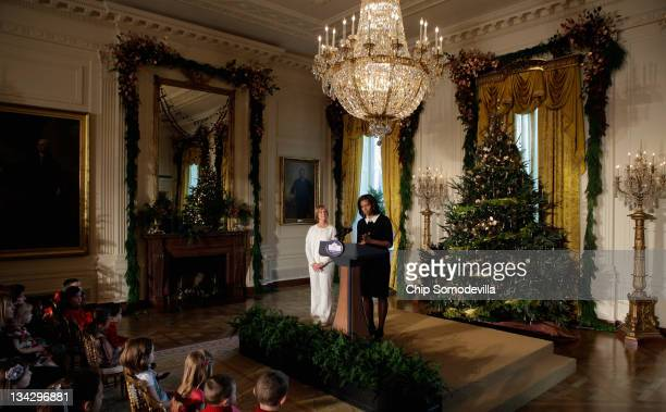 First lady Michelle Obama delivers remarks during the first viewing of the 2011 White House Christmas decorations with Gold Star Mother Jennifer...
