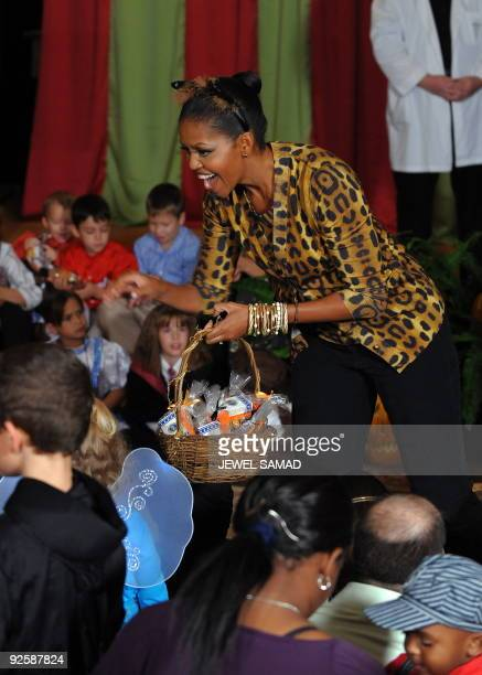 US First Lady Michelle Obama distributes candies and cookies as they host a Halloween reception for military families and children of White House and...