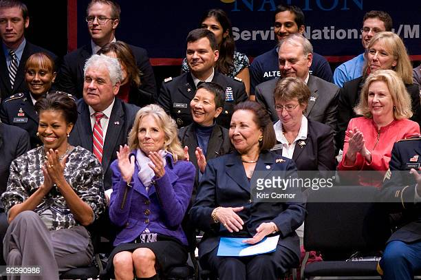 First Lady Michelle Obama Doctor Jill Biden wife of US Vice President Joe Biden and Alma Powell listen to Rob Gordon during the ServiceNation launch...