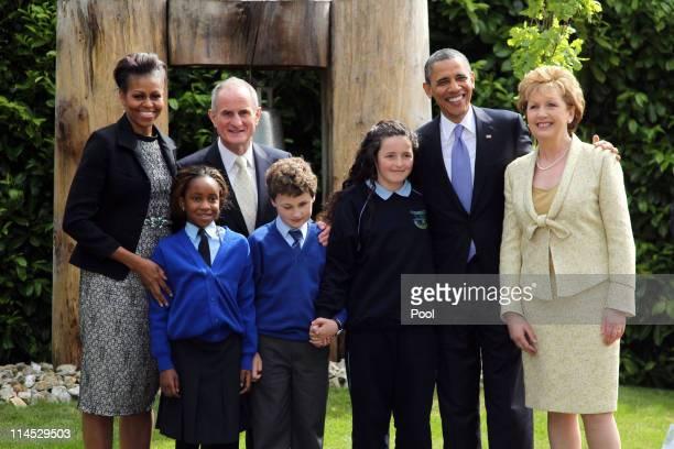 First lady Michelle Obama Dr Martin McAleese US President Barack Obama and Irish President Mary McAleese pose with school children Onyedika Ukachukwu...