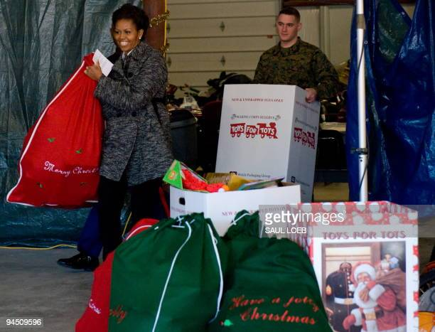 First Lady Michelle Obama drops off donated gifts from the White House Executive Office staff at the Toys for Tots warehouse in Stafford Virginia on...
