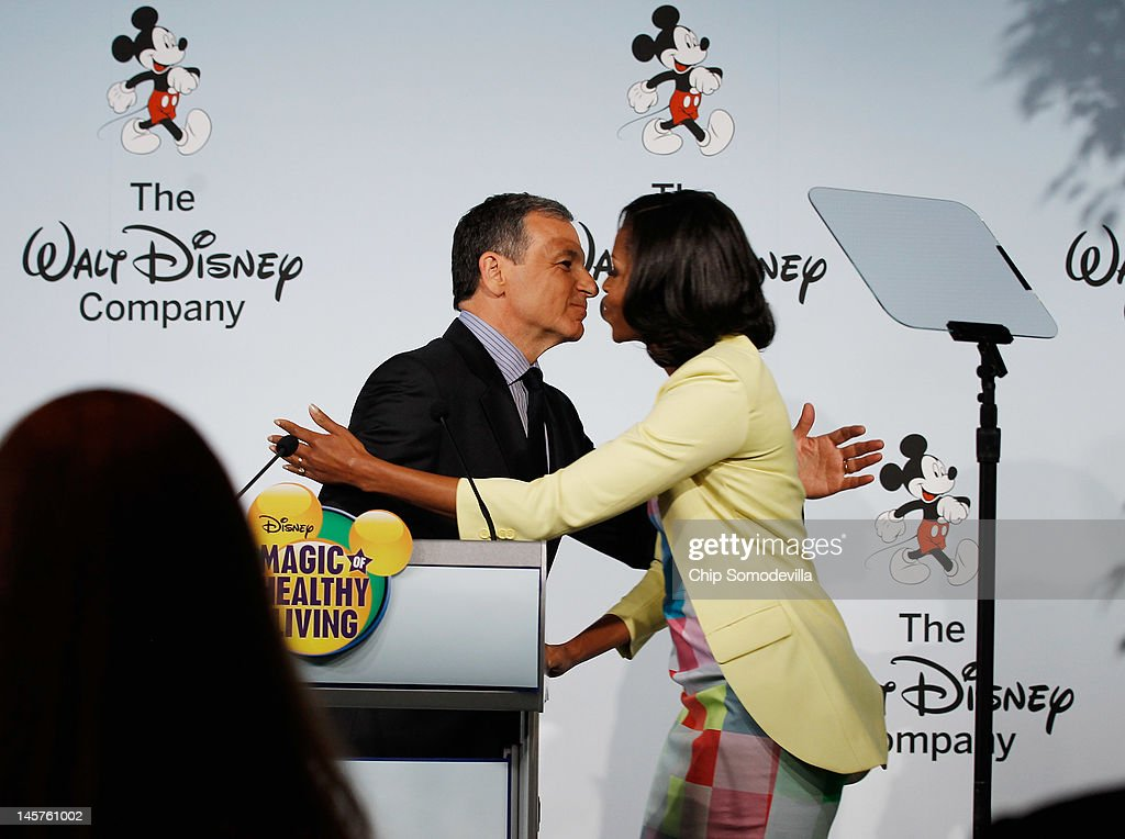 U.S. first lady Michelle Obama (R) embraces The Walt Disney Company Chairman and CEO Robert Iger during an event introducing The Walt Disney Company's 'Magic of Healthy Living' program at the Newseum June 5, 2012 in Washington, DC. As part of the new healthy eating initiative, all products advertised on Disney's child-focused television channels, radio stations and Web sites must adhear to a new set of strict nutritional standards. Addionally, Disney-licensed products that meet criteria for limited calories, saturated fat, sodium and sugar can display a logo - Mickey Mouse ears and a check mark - on their packaging.