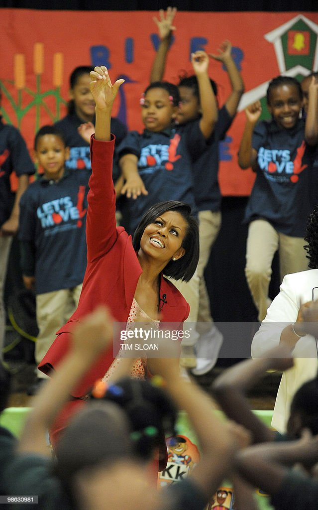 US First Lady Michelle Obama exercises with students at the River Terrace school for an an event highlighting physical activity as a critical element of the 'Let's Move' initiative on April 21, 2010 in the North East section of Washington, DC. AFP PHOTO / Tim Sloan