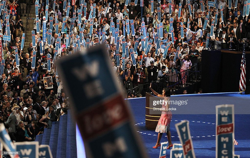 First lady Michelle Obama exits the stage after speaking during day one of the Democratic National Convention at Time Warner Cable Arena on September 4, 2012 in Charlotte, North Carolina. The DNC that will run through September 7, will nominate U.S. President Barack Obama as the Democratic presidential candidate.