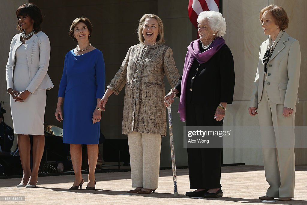 First lady Michelle Obama, former first lady Laura Bush, former first lady Hillary Clinton, former first lady Barbara Bush and former first lady Rosalynn Carter attend the opening ceremony of the George W. Bush Presidential Center April 25, 2013 in Dallas, Texas. The Bush library, which is located on the campus of Southern Methodist University, with more than 70 million pages of paper records, 43,000 artifacts, 200 million emails and four million digital photographs, will be opened to the public on May 1, 2013. The library is the 13th presidential library in the National Archives and Records Administration system.