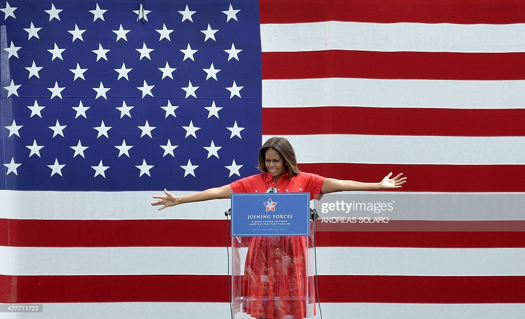 US First Lady Michelle Obama gestures as she delivers a speech to soldiers and guests at the United States and Nato military base in Vicenza on June 19, 2015.
