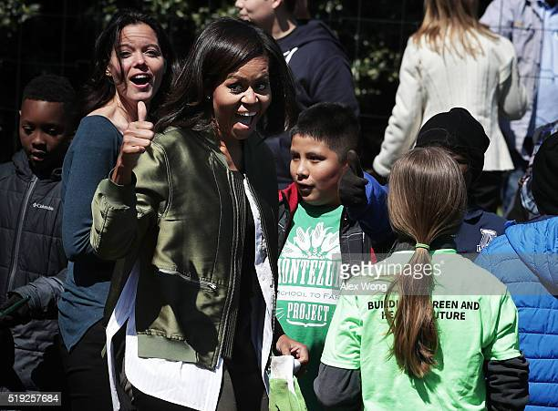 First lady Michelle Obama gestures as she plants the White House Kitchen Garden with students on April 5, 2016 in Washington, DC. The garden, which...