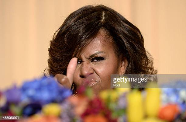 US First Lady Michelle Obama gives a thumbs up at the annual White House Correspondent's Association Gala at the Washington Hilton hotel May 3 2014...