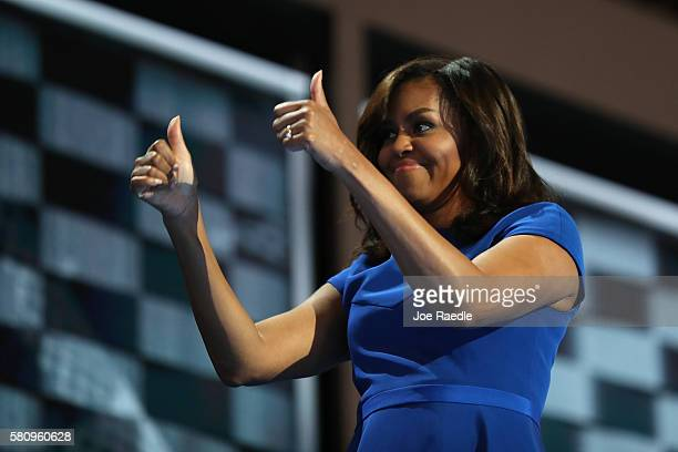 First lady Michelle Obama gives two thumbs up to the crowd after delivering remarks on the first day of the Democratic National Convention at the...