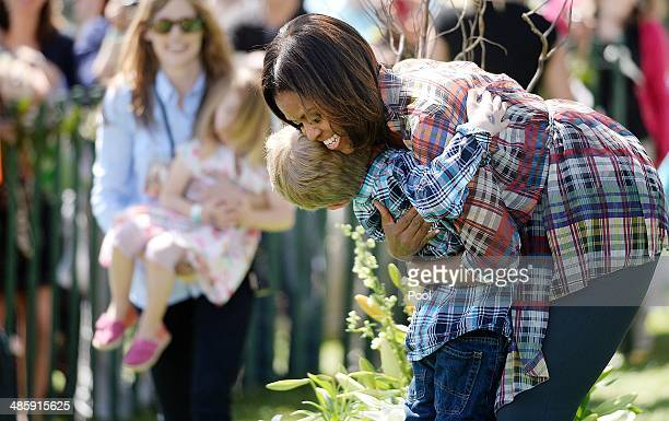 US first lady Michelle Obama greets kids after reading a the story My Garden during the annual White House Easter Egg Roll on the South Lawn of the...