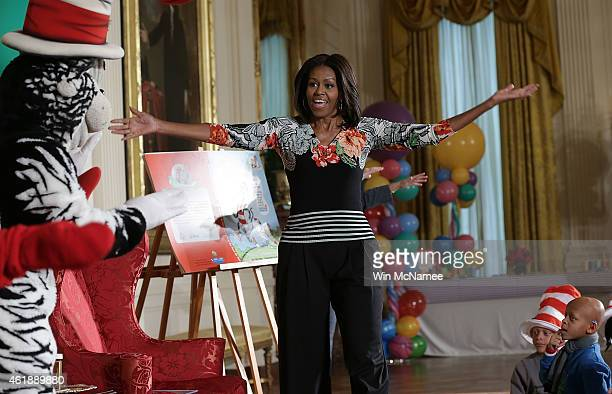 S first lady Michelle Obama greets local school children before reading a Dr Seuss book to them in the East Room of the White House on January 21...
