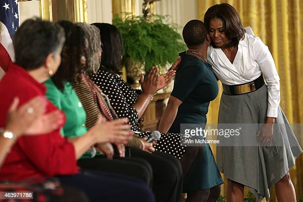 S first lady Michelle Obama greets members of a panel of intergenerational women who played a role in the civil rights movement during an event in...