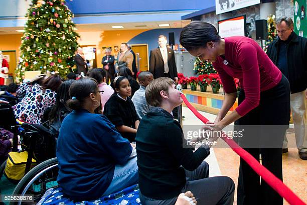 First Lady Michelle Obama greets patients and families while visiting Children's Hospital in Washington.