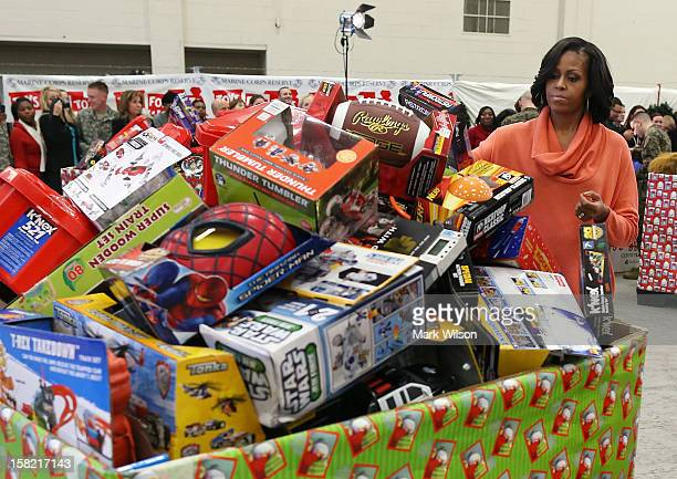 First lady Michelle Obama helps sort toys and gifts during an event at Joint Base AnacostiaBolling on December 11 2012 in Washiington DC The toys...