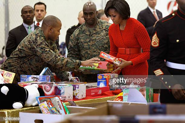 First lady Michelle Obama helps sort toys donated to the US Marine Corps Reserve Toys For Tots program at Joint Base AnacostiaBolling December 17...
