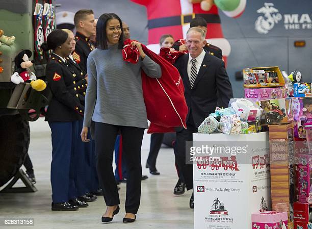 US First Lady Michelle Obama helps to sort donated toys for the Marine Corps Reserve Toys for Tots Campaign at Joint Base AnacostiaBolling in...