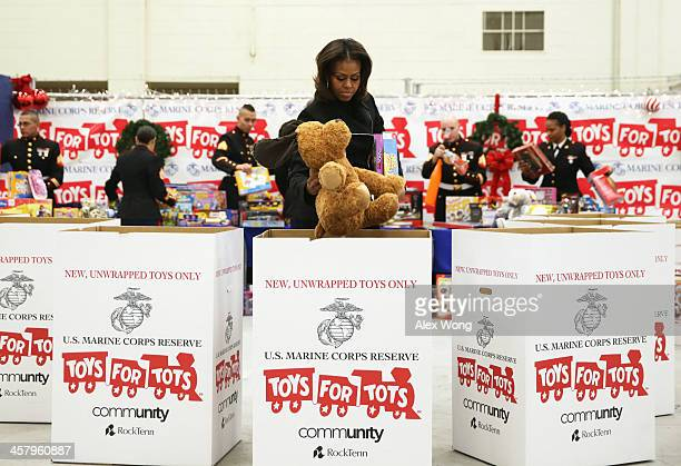 S first lady Michelle Obama helps to sort toys with Marines for the Marine Corps' Toys for Tots Campaign December 19 2013 at Joint Base...