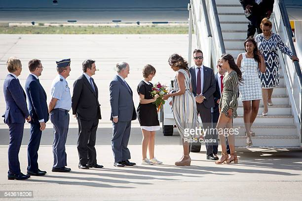 First Lady Michelle Obama her mother Marian Shields Robinson and her daughters Malia Obama and Sasha Obama arrive at Torrejon Air Force Base on June...