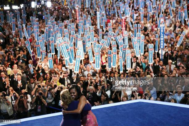First lady Michelle Obama hugs Elaine Brye on stage during day one of the Democratic National Convention at Time Warner Cable Arena on September 4,...