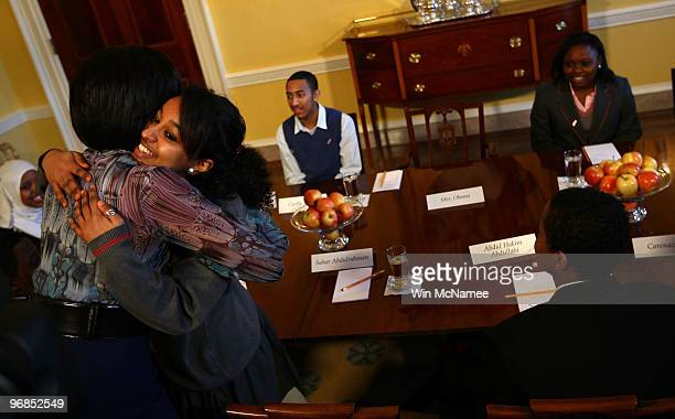 S first lady Michelle Obama hugs Sahar Abdulrahman as she greets students from schools across the London borough of Islington who were rewarded with...
