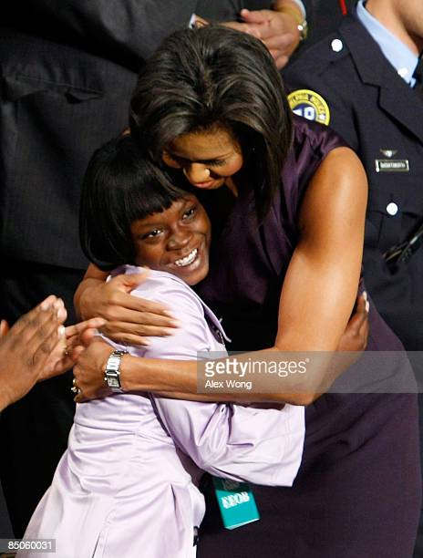 S First Lady Michelle Obama hugs Ty'Sheoma Bethea a student from Dillon South Carolina before her husband US President Barack Obama addresses a joint...