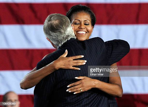 First lady Michelle Obama hugs US Senate Majority Leader Harry Reid after speaking at a getoutthevote rally at Canyon Springs High School November 1...