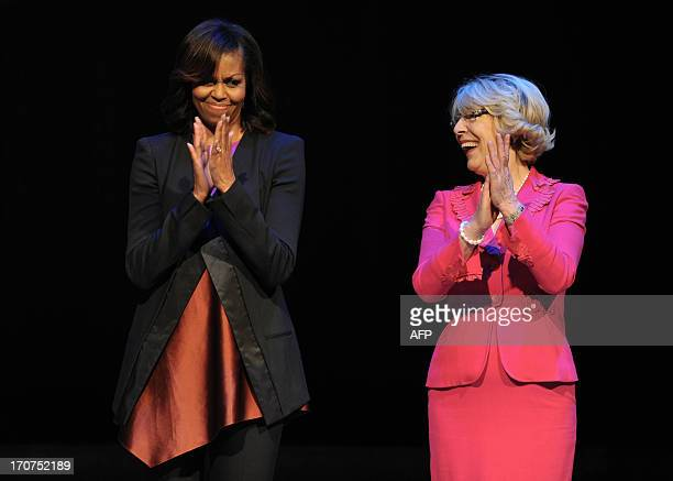First Lady Michelle Obama is pictured with Irish First Lady Sabina Higgins during a visit to Dublin's Gaiety Theatre in Dublin, Ireland, on June 17,...