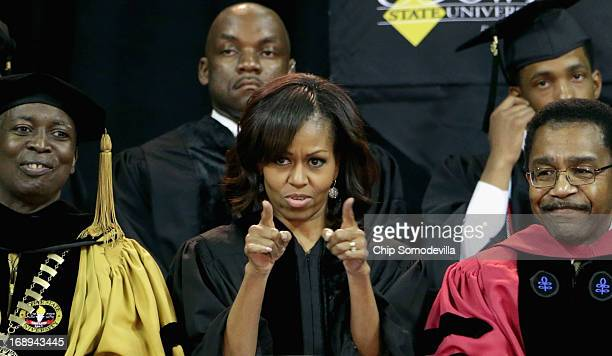 First lady Michelle Obama joins Bowie State University President Mickey Burnim and Provost Weldon Jackson on stage for the university's graduation...