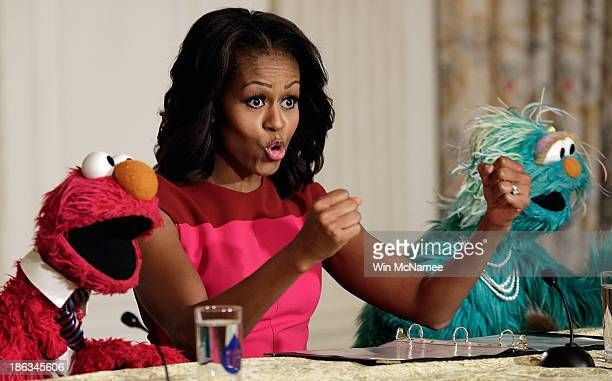 S first lady Michelle Obama joins with Sesame Street's Elmo and Rosalita for an announcement on a new initiative aimed at promoting healthier...