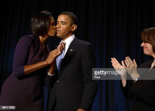 First lady Michelle Obama kisses President Obama after his speech at the 58th National Prayer Breakfast on February 4 2010 at the Washington Hilton...
