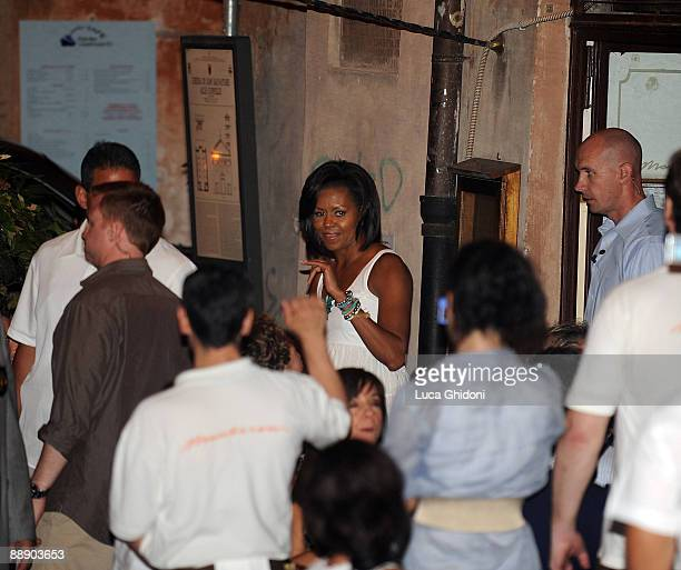 First Lady Michelle Obama leaves the Maccheroni restaurant on July 8, 2009 in Rome, Italy. The wives of the leaders attending the G8 summit have...