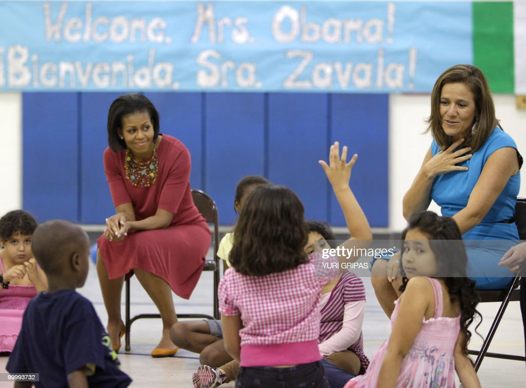 US First Lady Michelle Obama (L) listens as Mexican first lady Margarita Zavala talks to children as they visit New Hampshire Elementary School in Silver Spring, Maryland on May 19, 2010.